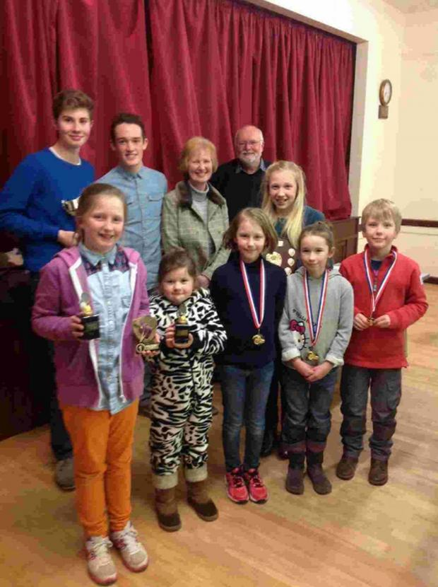 Dorset Echo: TROPHY WINNERS: Back from left, Ollie Lee, Levi Gale, Lesley Lee, Mike Kite, Olivia Willmore. Front, Daisy Parsons, Maisie Herbert, Lucy Reeves, Katie Shaw, Toby Reeves
