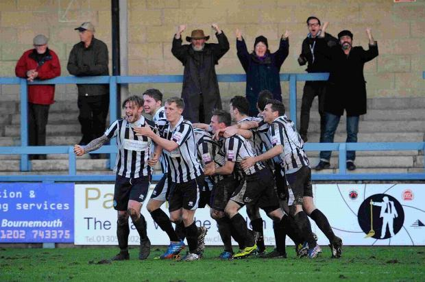 JAMIE'S JOY: Jamie Gleeson leads the celebrations after last weekend's win over leaders Bromley