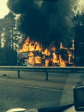 Dramatic bus fire causes traffic chaos