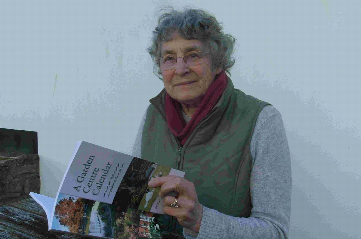 Marilyn Norvell with her book A Garden Centre Calendar
