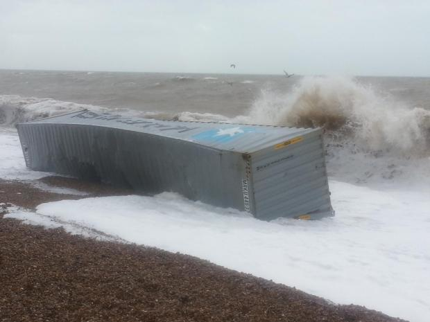 Dorset Echo: The beached shipping container at Axmouth. Photograph by Beer coastguard, MCA.