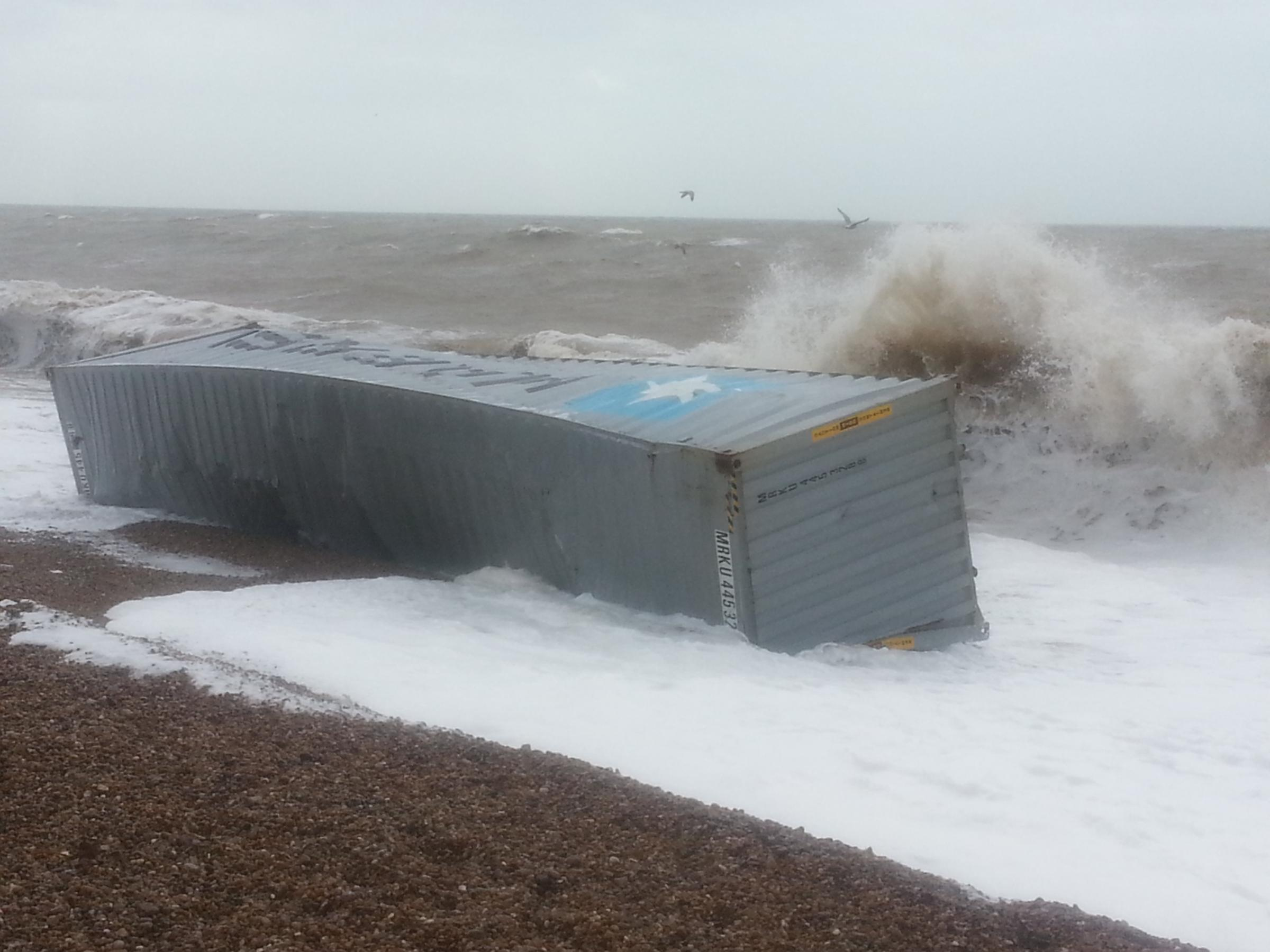 The beached shipping container at Axmouth. Photograph by Beer coastguard, MCA.