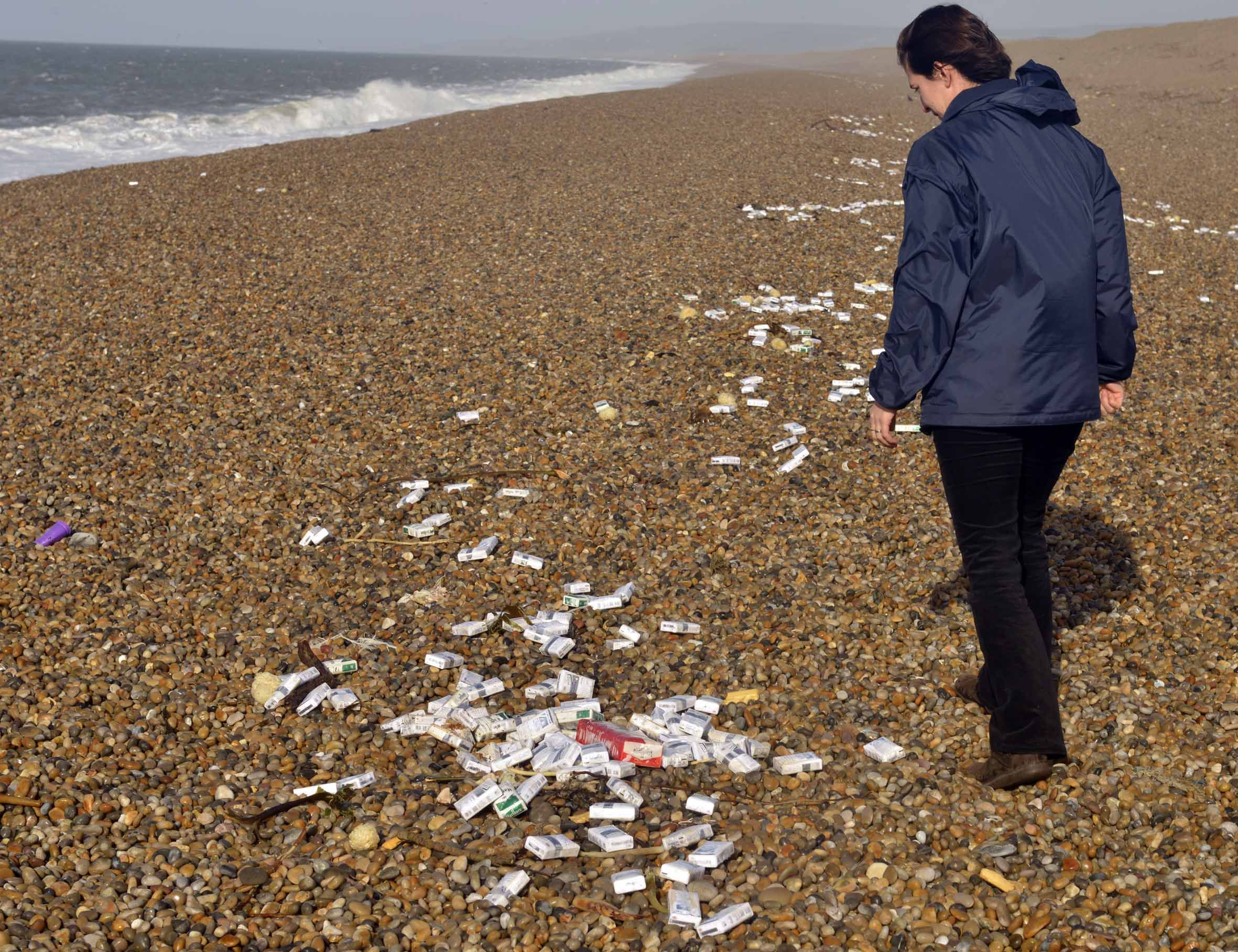 Thousands of cigarette packs wash up on Chesil Beach