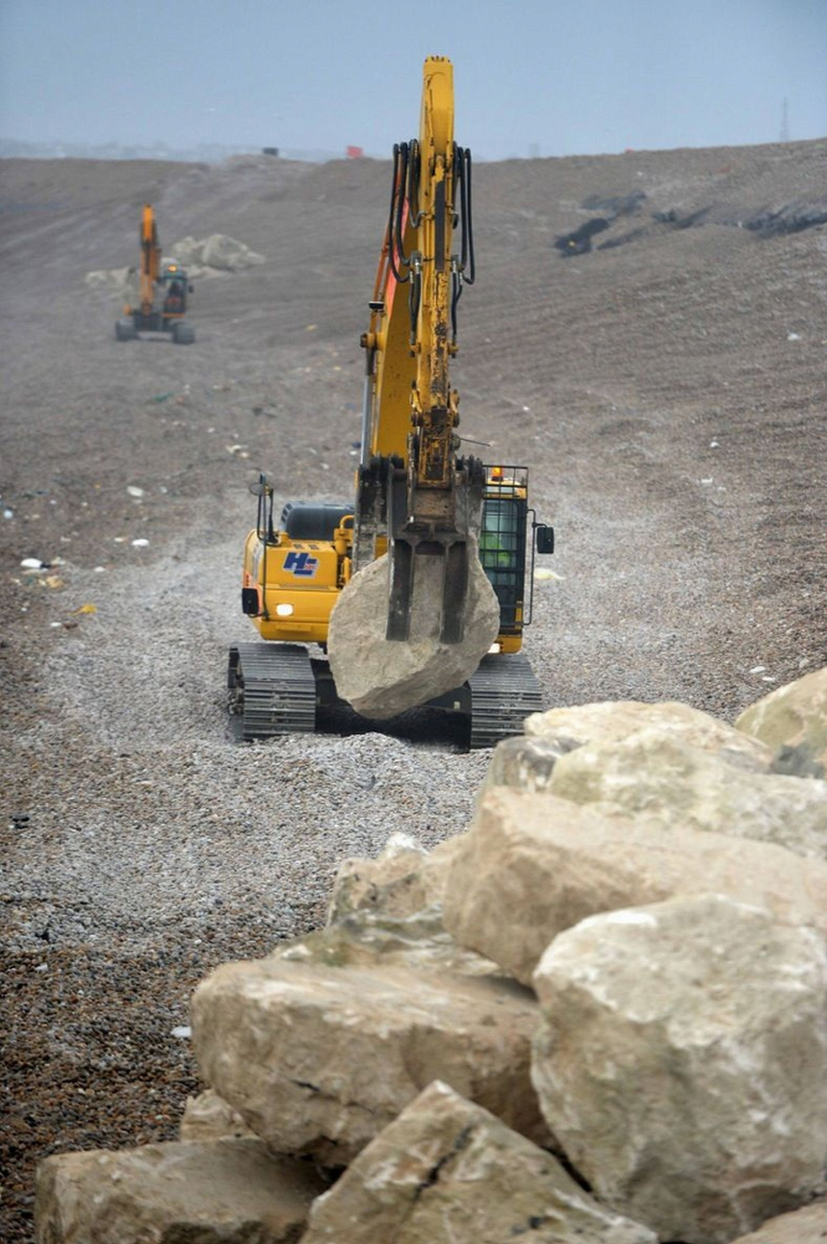 A digger on Chesil Beach
