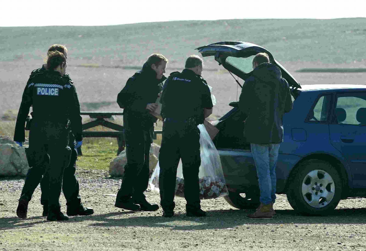 HAUL: Police and Border Agency staff with hundreds of packets of cigarettes they have intercepted from members of the public on Chesil Beach