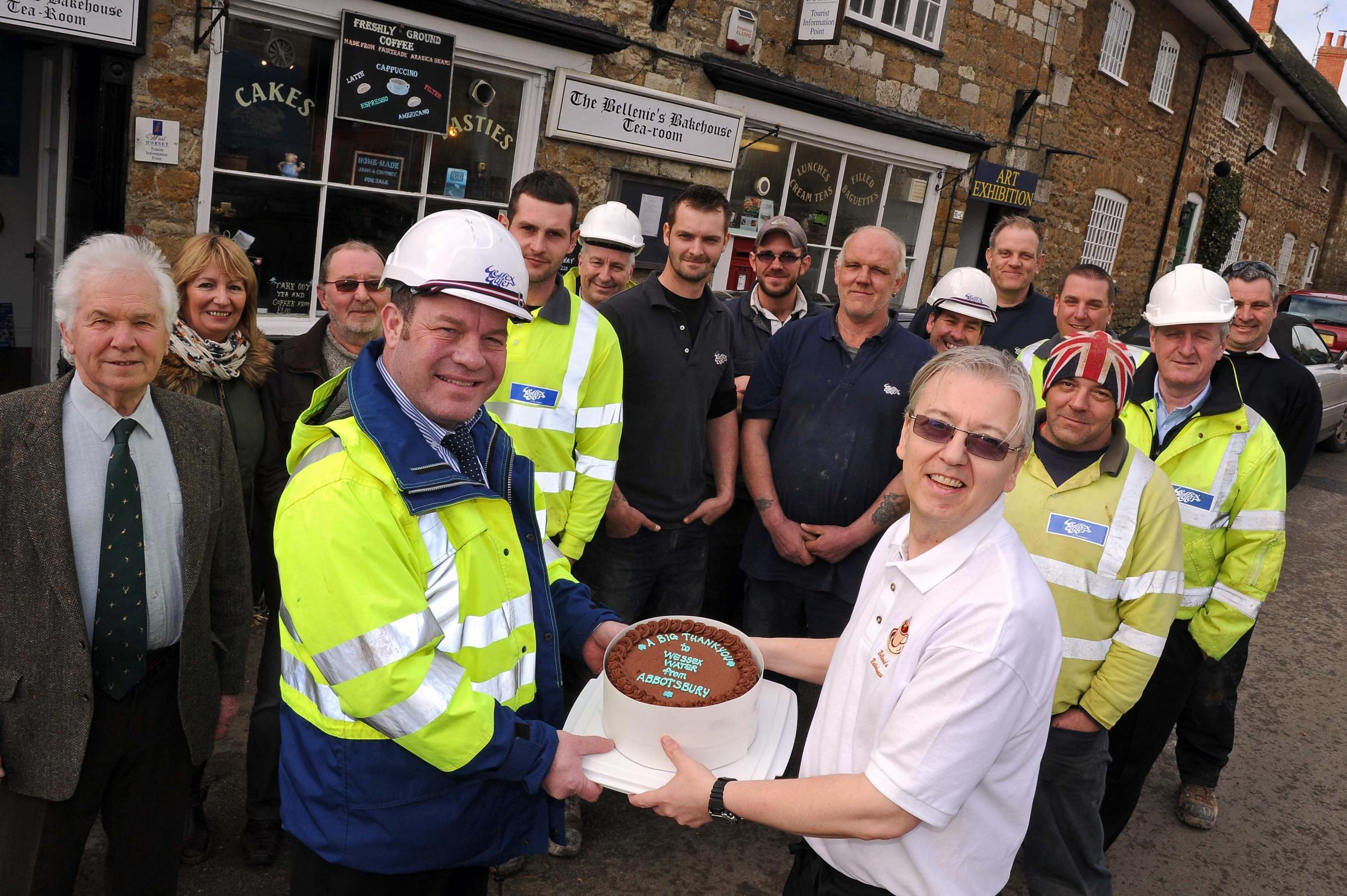 Steve Bellenie, right, from The Bellenie's Bakehouse in Abbotsbury, presents a cake to Wessex Water contracts manager Sean Dunne and staff