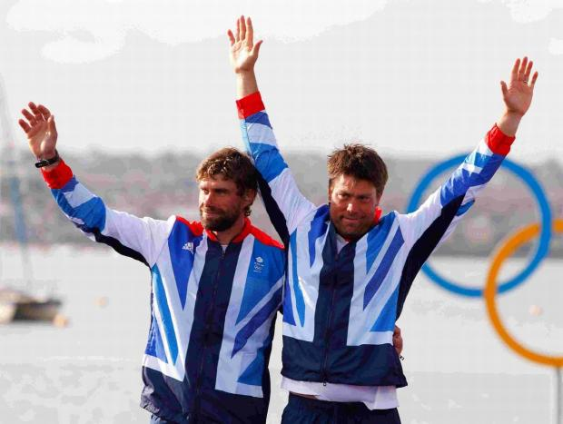 OLYMPIAN: Great Britain's Iain Percy and Andrew Simpson (right) celebrate on the podium after winning the Silver medal