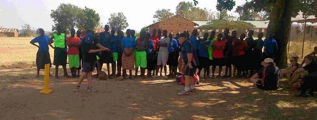 LEADING BY EXAMPLE: Grant Neven, right, leads a coaching session at Arua Girls Secondary