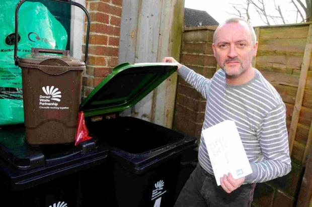 RUBBISH  COMPLAINT: Councillor David Taylor is sending a  letter to the council saying he is going to charge rent for imposing bins on his property