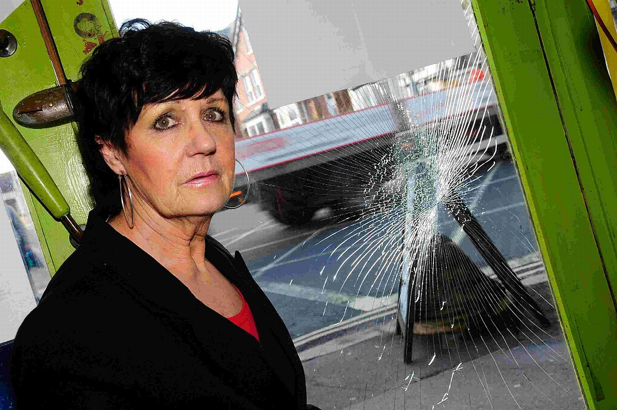 SMASHED: Party shop owner Jan O'Brien shows the damage