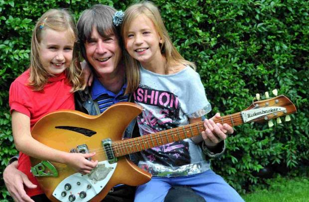 NUMBER ONE: Richard Hymas with daughters Libby and Hollie