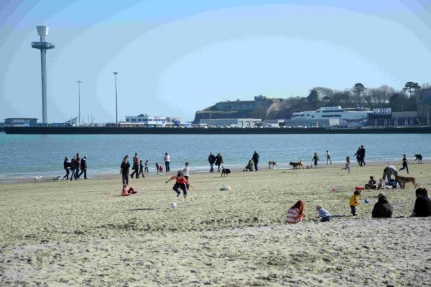 SPRING HAS SPRUNG: Visitors have fun in the sun on Werymouth Beach