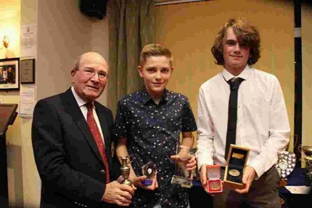 BIG WINNER: Sean Dimmick, centre, with club captain Colin Huckle, left, and Luke Maddison