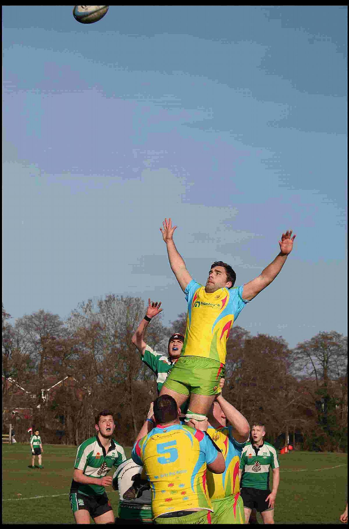 THRASHED: Dorchester Seconds (green shirts) battle in vain against Dorset Dockers on Saturday