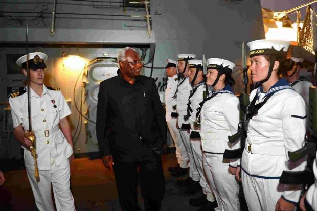 HONOUR: Royal Navy warship HMS Portland pulled out all the stops to impress the President of Sierra Leone His Excellency Dr Ernest Bai Koroma
