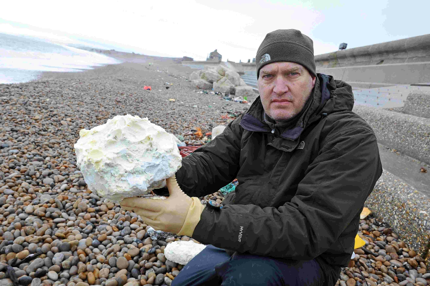 Conservationist Steve Trewhella with a lump of rubbish washed up at Chesil Beach