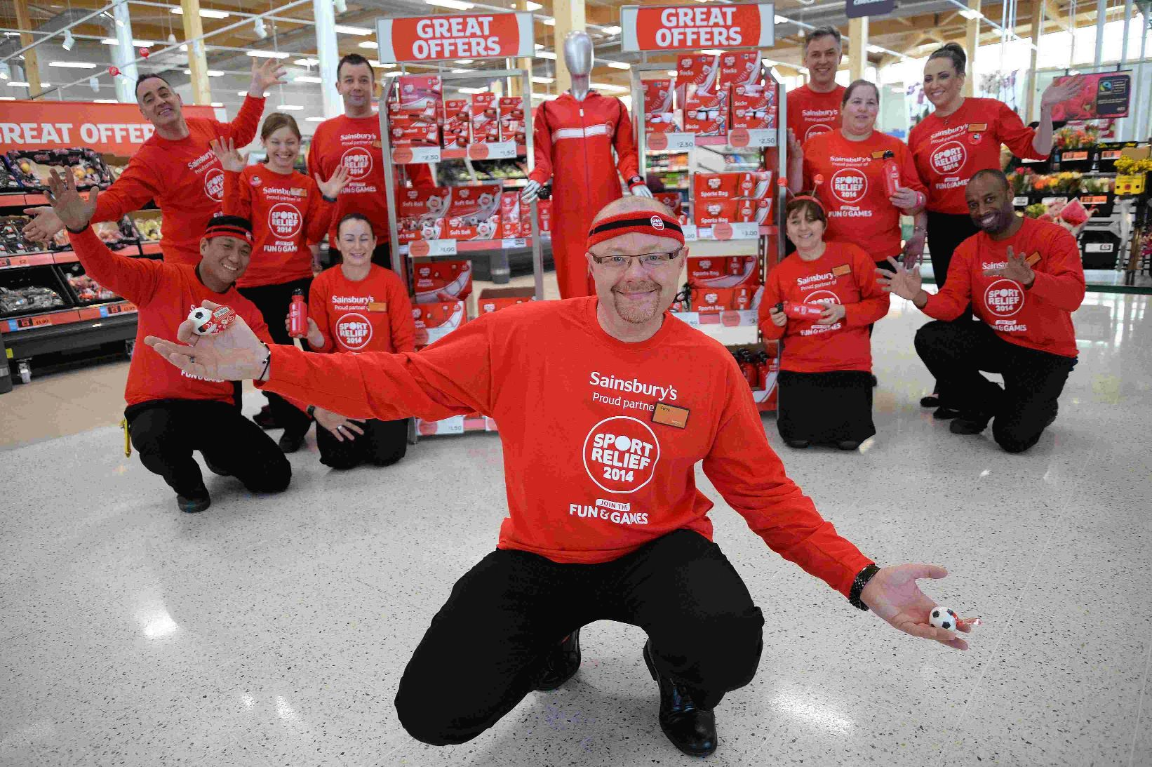DANCE OFF: Sainsburys manager Steve Jones with staff get ready for Sport relief
