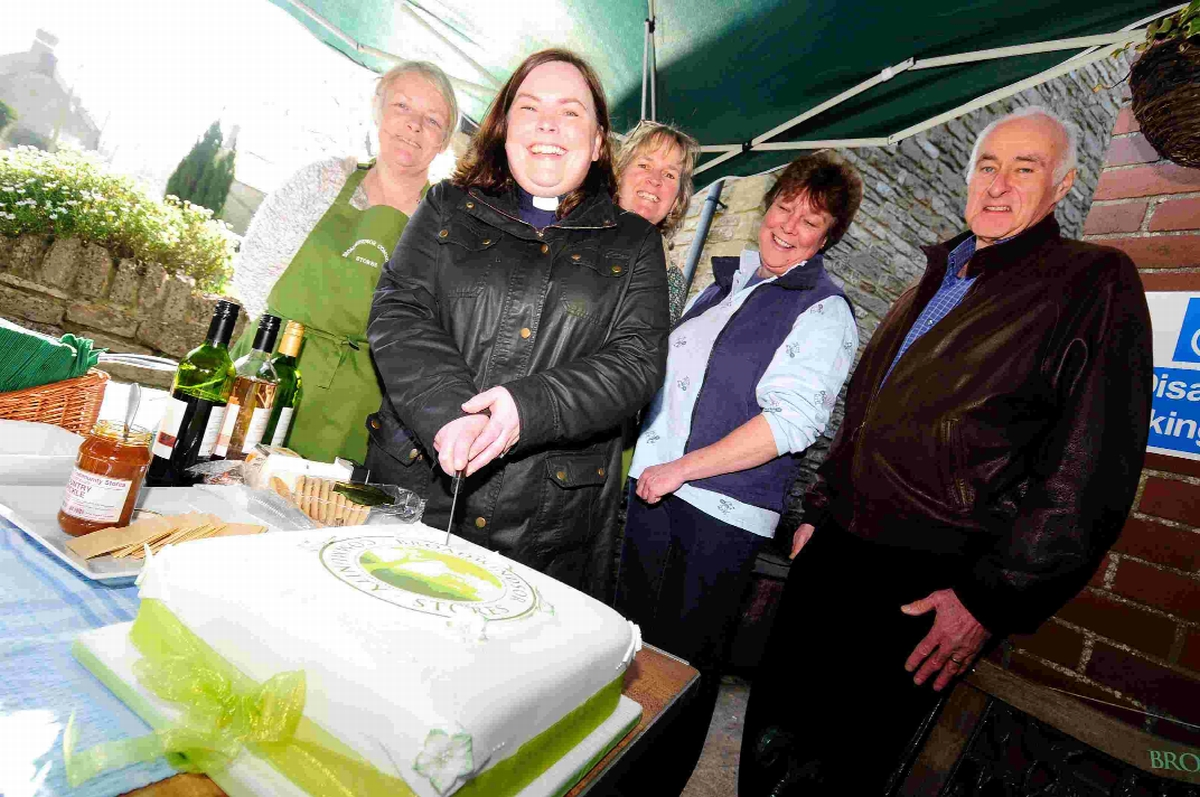 SAVED: The Rev Jo Neary cuts the cake watched by Sue Williams, Mandy Crane, Jane Sloman and Fraser Hughes