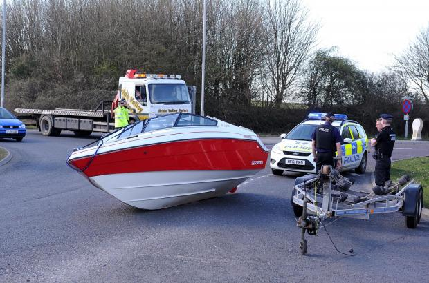 Dorset Echo: OBSTRUCTION: The speedboat at the roundabout. Picture by Finnbarr Webster