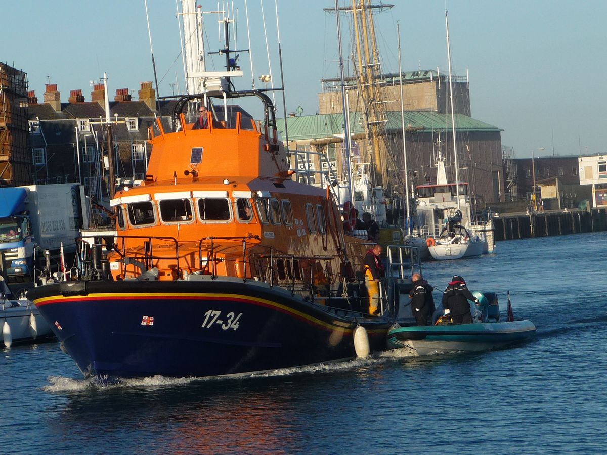 RESCUE: Weymouth Lifeboat tows the vessel in Weymouth Harbour. Picture Weymouth RNLI