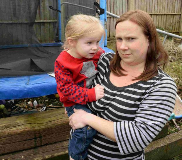 Dorset Echo: Samantha Broughton and daughter Olivia with the vandalised trampoline