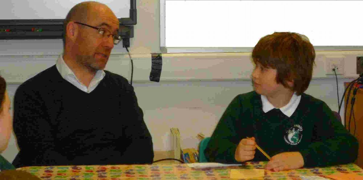 FACING A GRILLING: Former Dorset South MP, Lord Knight of Weymouth, answers questions on a range of political and social topics from pupils at Holy Trinity Primary School in Weymouth. Here Lord Knight is being interviewed by Harry