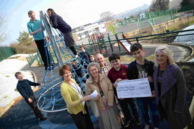 GRATEFUL: Westfield College receive funds for new play area. From left, Jenny Savage, Nina and Roger Hanger, pupils Thomas and Conner and Jacqui Norman.