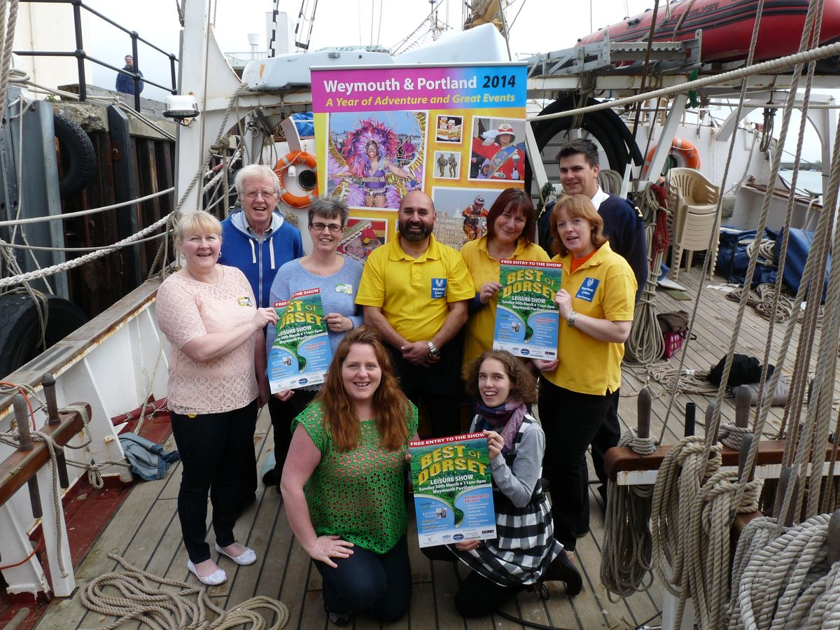 AHOY THERE: Cllr Ian Bruce, back left, is joined by participants and organisers of the Best of Dorset Show including Asda George, Dorset Volunteers, TS Pelican and the Weymouth and Portland Events Team