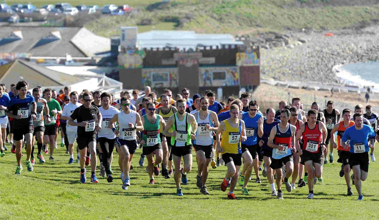 FLYING START: The runners start the race at Bowleaze Cove