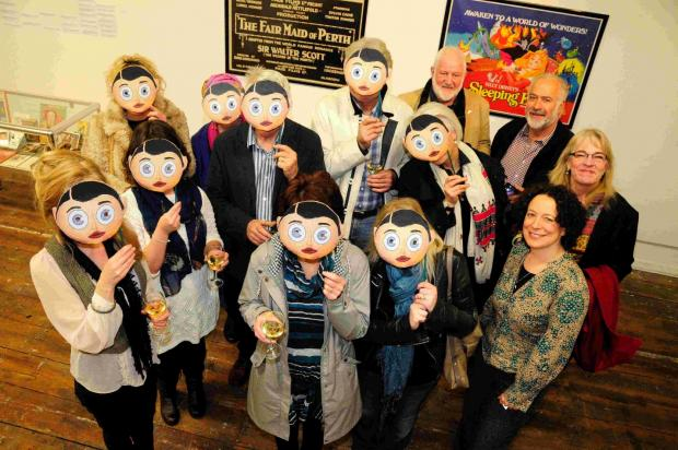 Bridport Arts Centre director Polly Gifford with friends and sponsors of the festival, most of whom are sporting Frank Sidebottom masks