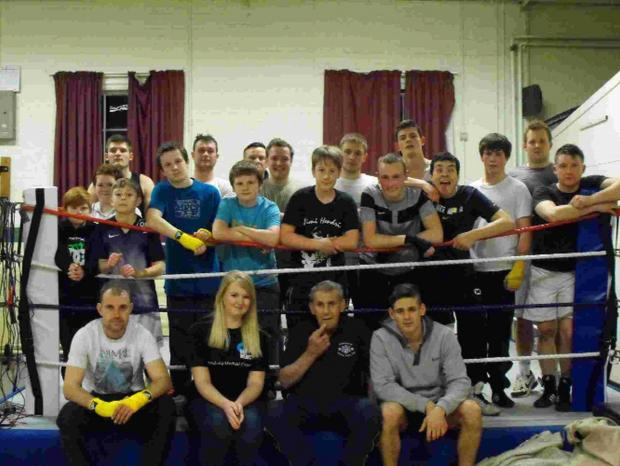Paige Sewell, second from left on front row, with members of the Dorchester and District Amateur Boxing Club