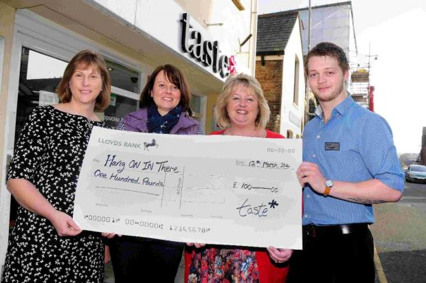 CHEQUE POINT: From left, Elizabeth Clark, Louise Moffat, Nicola Cumber and Ross Cumber