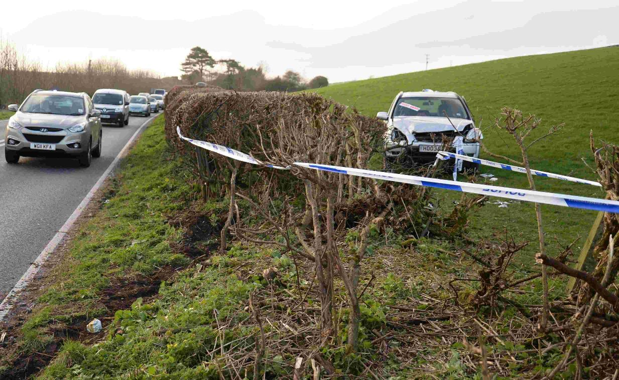 CAR FLIPS: A35 crash scene near Winterbourne Abbas
