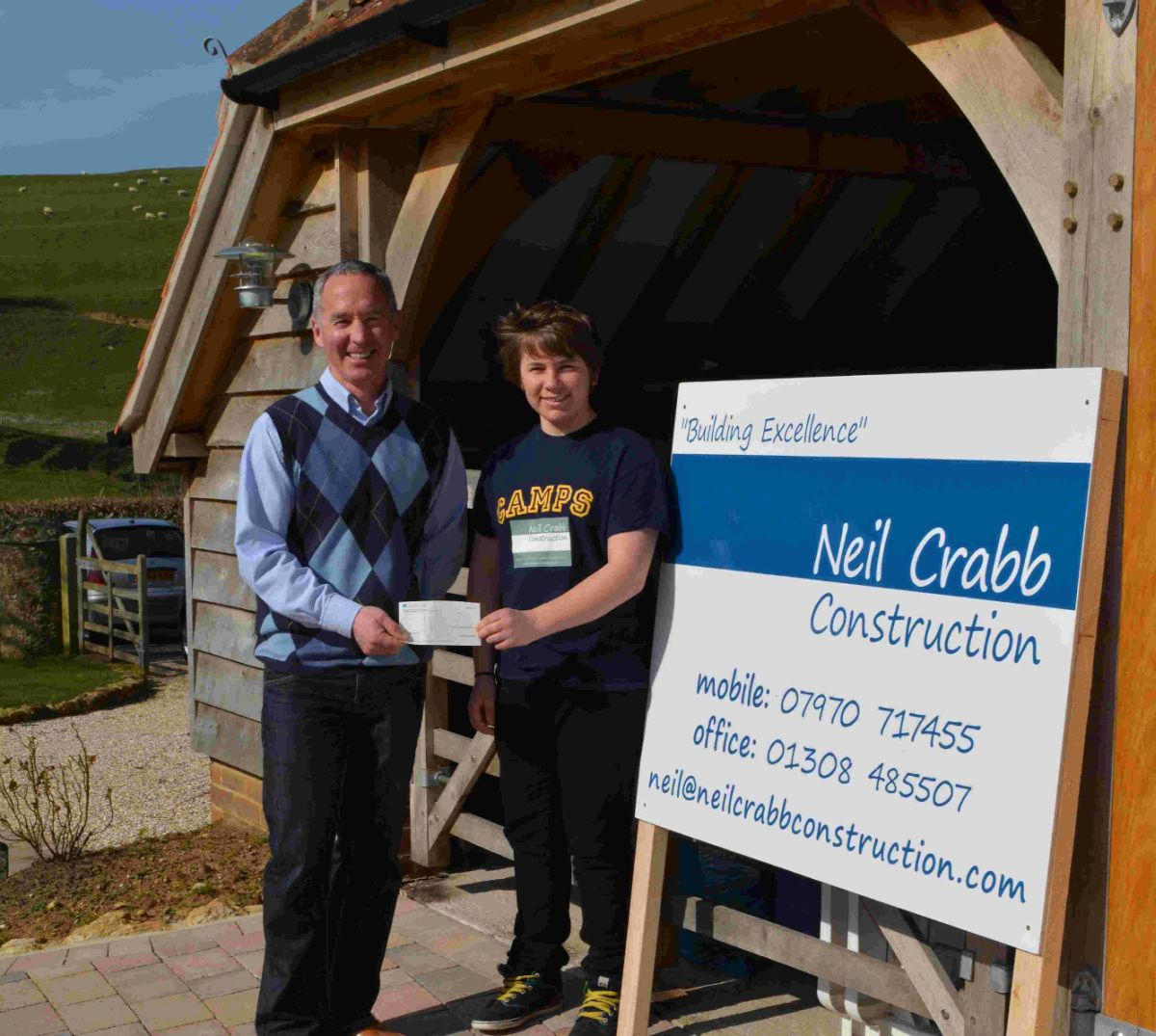 Joseph Neil Crabb, 15, receives a £200 boost from his uncle Neil Crabb