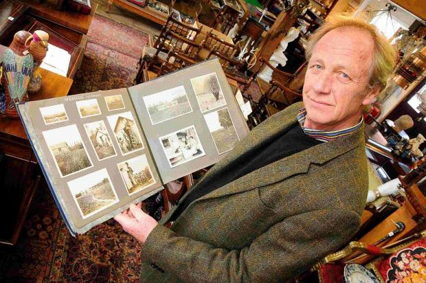 EVOCATIVE: Michael Dark, owner of Bridport Auction House, with the photo album