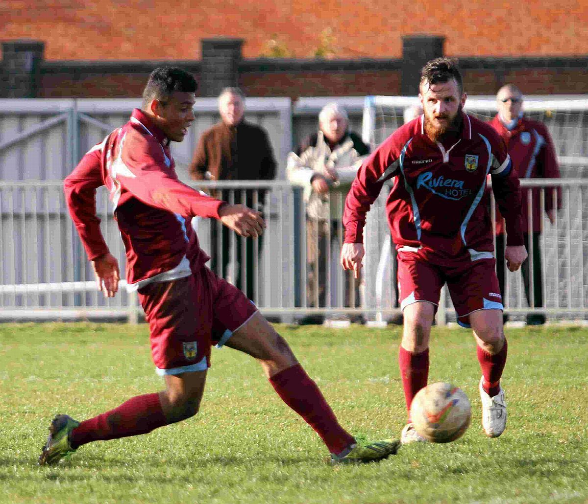 IN-FORM: Isaac Vassell scores at Burnham, watched by Stewart Yetton