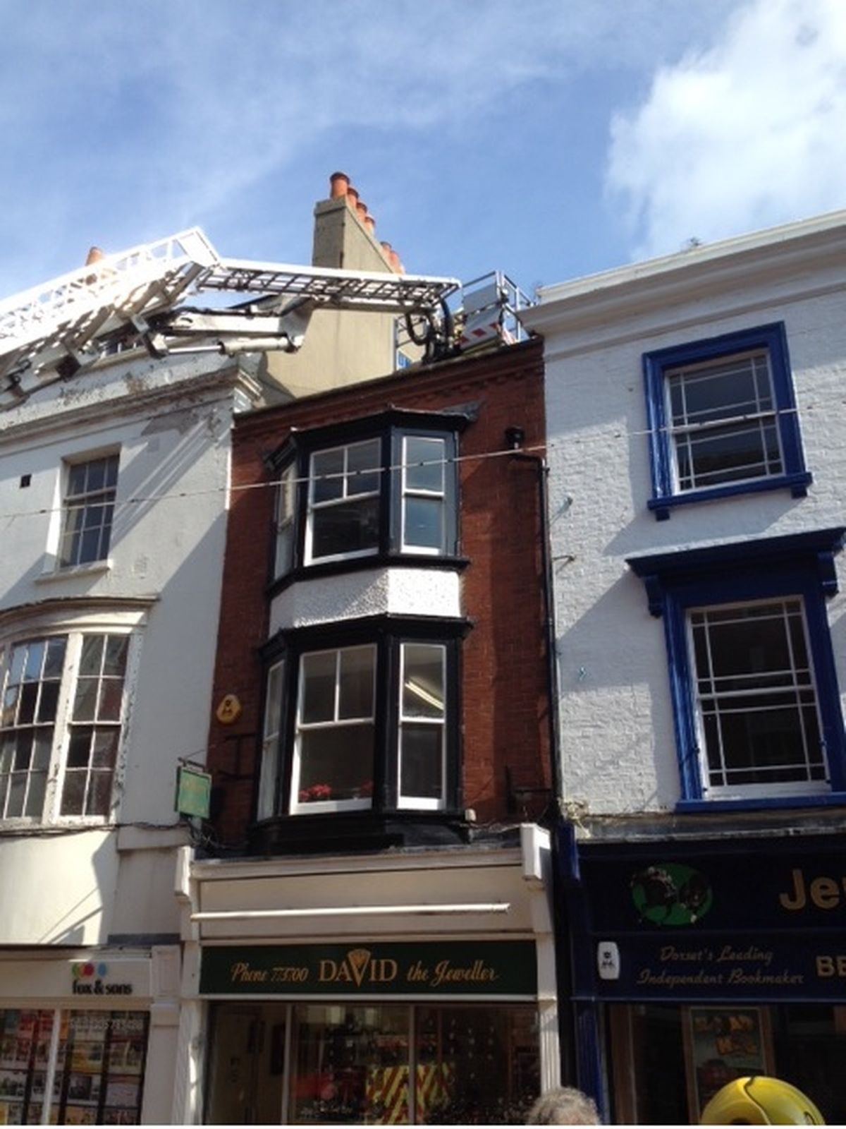 Firefighters rescue trapped bird in Weymouth town centre
