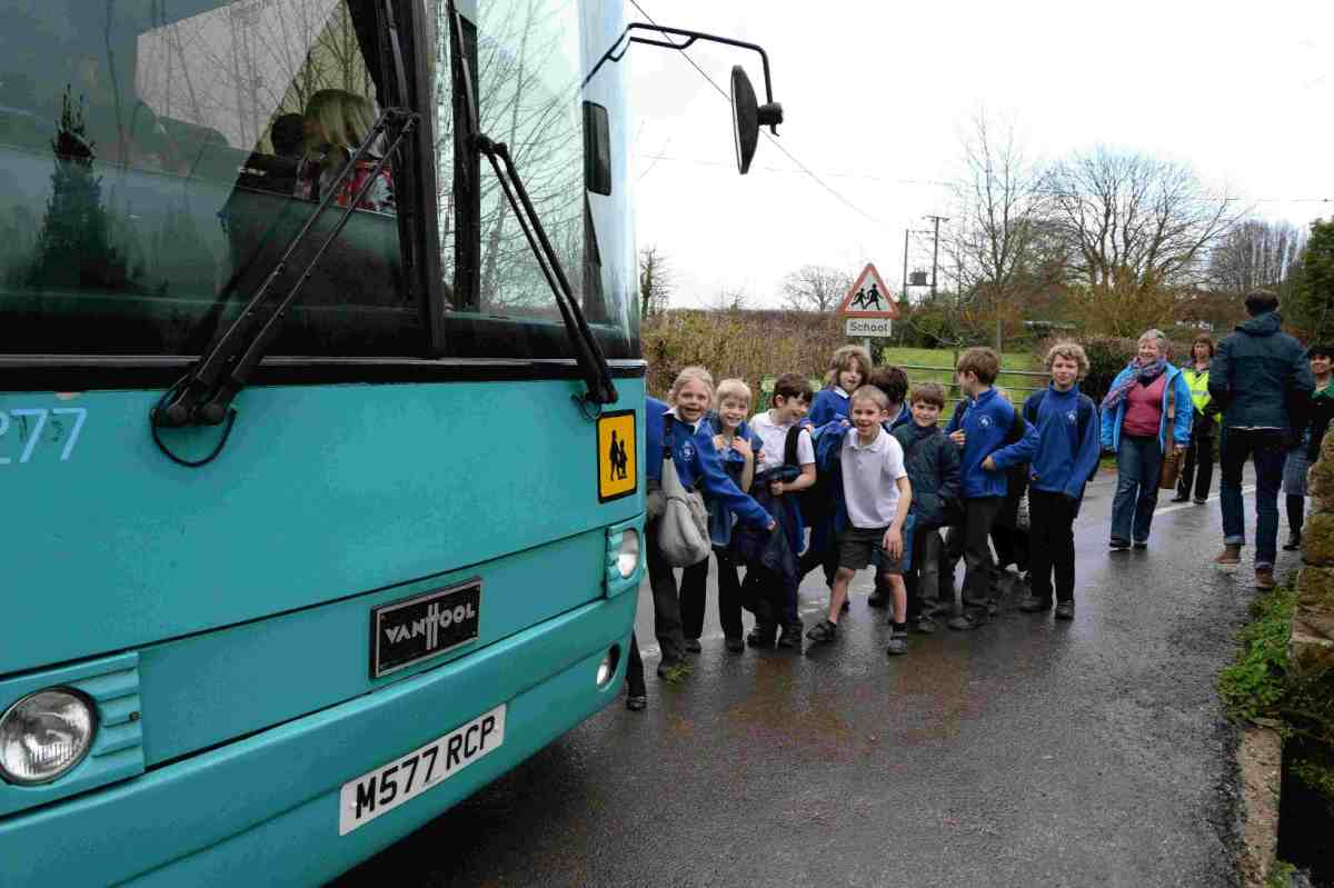 BIG ISSUE: Litton Cheney school pupils make their way down a narrow lane to meet the bus