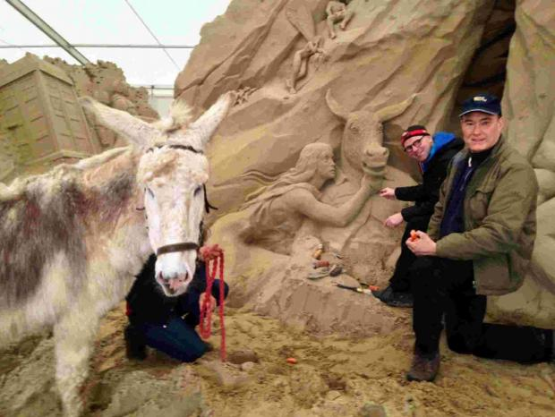 MULE BE LUCKY:  From left, Gracy the donkey, sculptor Wilfred Stijger, and Mark Anderson