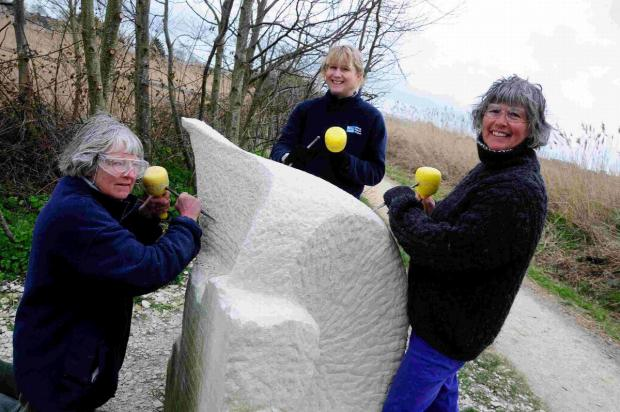 Dorset Echo: CARVE UP: Mary Harman, Michelle Williams and Sarah Gilpin working on the sculpture at Radipole Lake RSPB nature reserve
