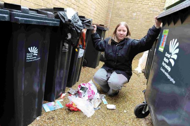 OUTRAGE: Amy Nash, with the uncollected bins