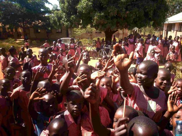 FRIENDLY WELCOME: Youngsters at Agijado Primary School in Lira welcome Grant Neven