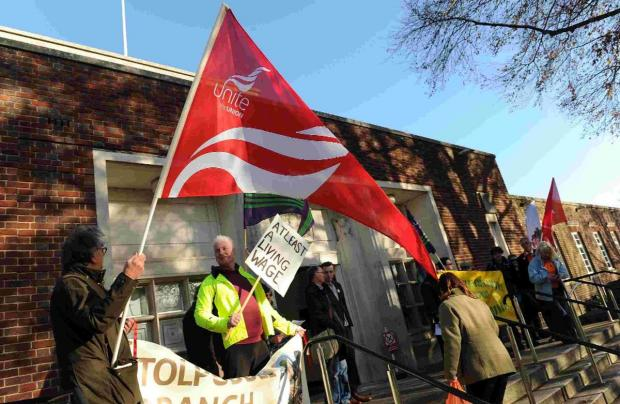 Dorset Echo: PROTEST: Trade union members campaign for a living wage outside County Hall