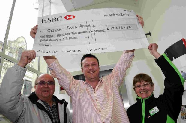 Dorset Echo: CHEQUE POINT: From left, Calvin Stone, Wayne Ingram and Sandy West