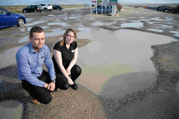 Dorset Echo: Taste cafe employees Martin Smith and Tiffany Eccles in the potholed car park at the Chesil Beach Centre