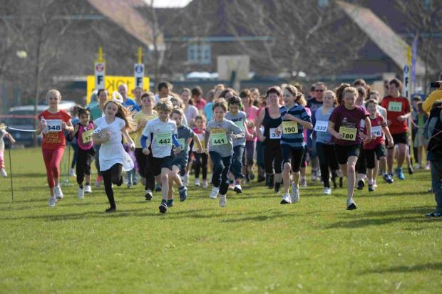 Dorset Echo: RACING AHEAD: Children lead the pack in the fun run