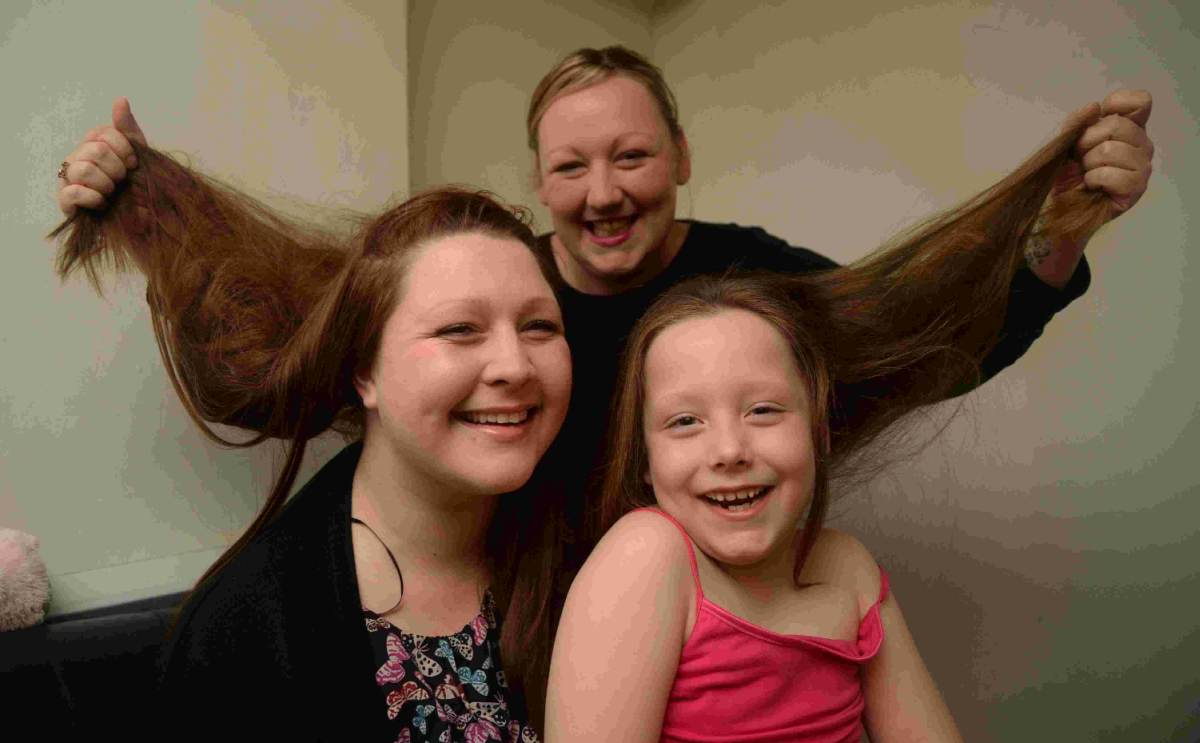 HAIR WE GO: Gemma Snow, left,  with her niece Ruby Snow and Ruby's mum Kerrie