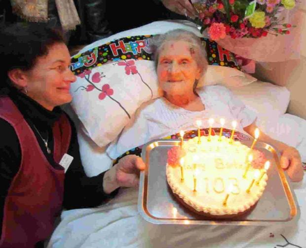 PARTY: Queenie Hodge celebrates her 103rd birthday  at Coneygar Lodge with  staff member Louisa Roper