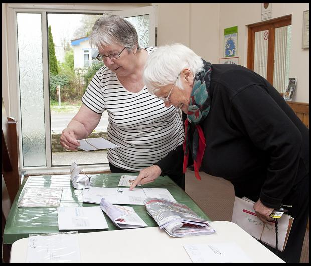 June Manning and Tilly Gordon collecting their mail from the makeshift sorting office on the park. Photo credit: BNPS