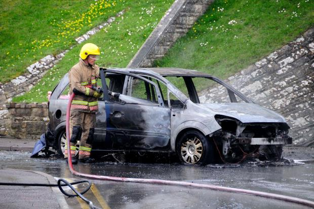 Black smoke 'billowing' into the air as fire crews battle car fire at HMP Verne